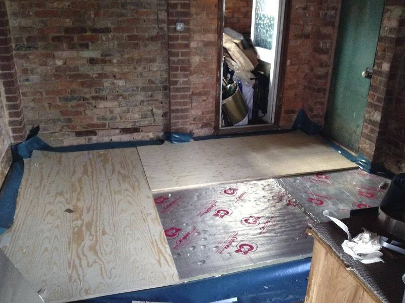 Insulation down, plywood next